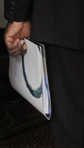 Man holding brochure